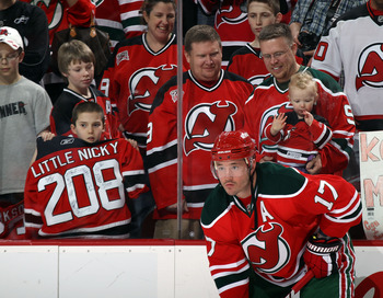 NEWARK, NJ - MARCH 18:  Ilya Kovalchuk #17 of the New Jersey Devils shows off the teams throwback jerseys during warmups prior to his game against the Washington Capitals at the Prudential Center on March 18, 2011 in Newark, New Jersey.  (Photo by Bruce B