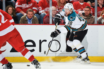 DETROIT - MAY 4: Dany Heatley #15 of the San Jose Sharks skates with the puck against the Detroit Red Wings in Game Three of the Western Conference Semifinals during the 2011 NHL Stanley Cup Playoffs on May 4, 2011 at Joe Louis Arena in Detroit, Michigan.