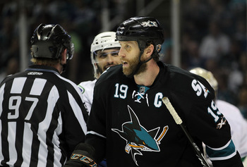 SAN JOSE, CA - MAY 22:   Joe Thornton #19 of the San Jose Sharks skates away from Maxim Lapierre #40 of the Vancouver Canucks in Game Four of the Western Conference Finals during the 2011 Stanley Cup Playoffs at HP Pavilion on May 22, 2011 in San Jose, Ca