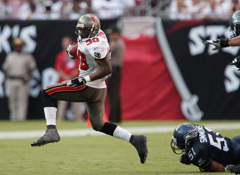 TAMPA, FL - SEPTEMBER 19: Charlie Garner #30 of the Tampa Bay Buccaneers runs away from Anthony Simmons #51 of the Seattle Seahawks during the second half of the game won by the Seahawks 10-6 at Raymond James Stadium on September 19, 2004 in Tampa, Florid