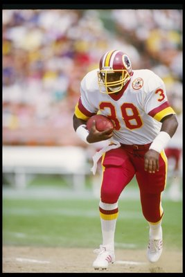21 Sep 1986:  Running back George Rogers of the Washington Redskins moves the ball during a game against the San Diego Chargers at Jack Murphy Stadium in San Diego, California.  The Redskins won the game, 30-27. Mandatory Credit: Rick Stewart  /Allsport