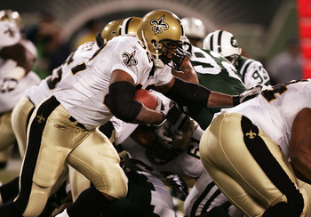 EAST RUTHERFORD, NJ - NOVEMBER 27:  Antowain Smith #32 of the New Orleans Saints rushes against the New York Jets during their game on November 27, 2005 at Giants Stadium in East Rutherford, New Jersey. The Saints defeated the Jets 21-19.  (Photo by Al Be