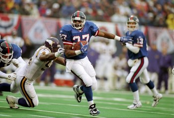 27 Dec 1997:  Running back Rodney Hampton of the New York Giants  tries to break away from defensive lineman Tony Williams of the Minnesota Vikings during a game at Giants Stadium in East Rutherford, New Jersey.  Minnesota won the game 23-22. Mandatory Cr