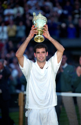 9 Jul 2000:  Pete Sampras of the USA raises the trophy after victory in the mens final against Patrick Rafter of Australia at the Wimbledon Lawn Tennis Championship at the All England Lawn Tennis and Croquet Club, Wimbledon, London. Sampras won in four se