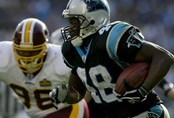 CHARLOTTE, NC - NOVEMBER 16:  Darrell Russell #96 of the Washington Redskins fails to stop Stephen Davis #48 of the Carolina Panthers on November 16, 2003 at Ericsson Stadium in Charlotte, North Carolina.  (Photo by Craig Jones/Getty Images)