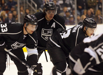 LOS ANGELES, CA - MARCH 03:  Willie Mitchell #33, Anze Kopitar #11 and Dustin Brown #23 of the Los Angeles Kings line up in position for a defensive zone faceoff late in the third period of their NHL game against the Phoenix Coyotes at Staples Center on M