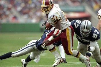 4 Oct 1998:  Running back Terry Allen #21 of the Washington Redskins in action during a game against the Dallas Cowboys at the Jack Kent Cooke Stadium in Raljon, Maryland. The Cowboys defeated the Redskins 31-10.