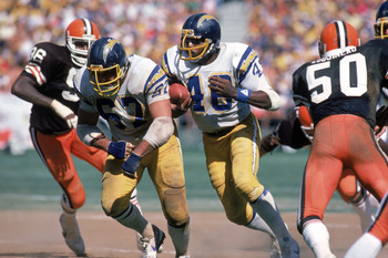 SAN DIEGO - SEPTEMBER 25:  Running back Chuck Muncie #48 of the San Diego Chargers runs behind the protection of teammate offensive guard Ed White #67 during a game agianst the Cleveland Browns at Jack Murphy Stadium on September 25, 1983 in San Diego, Ca