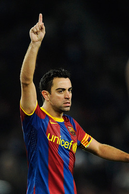 BARCELONA, SPAIN - JANUARY 02:  Xavi Hernandez of Barcelona reacts during the La Liga match between Barcelona and Levante UD at Camp Nou on January 2, 2011 in Barcelona, Spain. Barcelona won 2-1. Xavi Hernandez is set to make Barcelona history after this