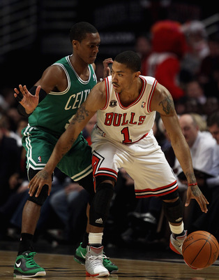 CHICAGO, IL - APRIL 07: Derrick Rose #1 of the Chicago Bulls moves against Rajon Rondo #9 of the Boston Celtics at United Center on April 7, 2011 in Chicago, Illinois. The Bulls defeated the Celtics 97-81. NOTE TO USER: User expressly acknowledges and agr