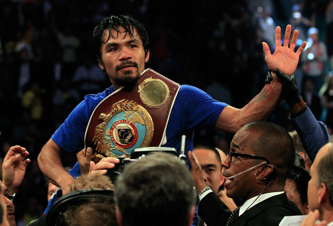 LAS VEGAS, NV - MAY 07:  Manny Pacquiao of the Philippines celebrates after his unanimous decision victory against Shane Mosley in the WBO welterweight title fight at MGM Grand Garden Arena on May 7, 2011 in Las Vegas, Nevada.  (Photo by Chris Trotman/Get