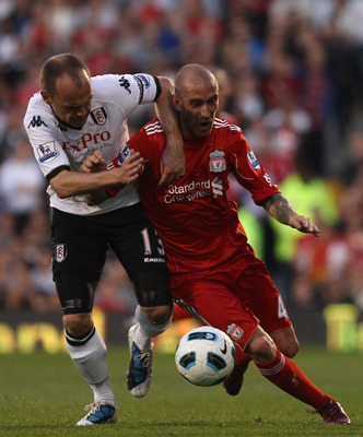 LONDON, ENGLAND - MAY 09:  Danny Murphy of Fulham fights for the ball with Raul Meireles of Liverpool during the Barclays Premier League match between Fulham and Liverpool at Craven Cottage on May 9, 2011 in London, England.  (Photo by Scott Heavey/Getty