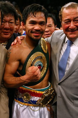 LAS VEGAS - MAY 02:  Manny Pacquiao of the Philippines celebrates with promoter Bob Arum after knocking down Ricky Hatton of England in the second round during their junior welterweight title fight at the MGM Grand Garden Arena May 2, 2009 in Las Vegas, N