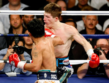 LAS VEGAS - MAY 02:  Manny Pacquiao of the Philippines hits Ricky Hatton of England during the first round of their junior welterweight title fight at the MGM Grand Garden Arena May 2, 2009 in Las Vegas, Nevada. Pacquiao defeated Hatton by a second round