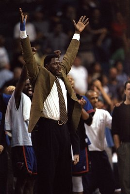 3 May 1998:  Patrick Ewing #33 of the New York Knicks celebrates from the bench during game five, of the first round of the Eastern Conference Playoffs against the Miami Heat at the Miami Arena in Miami, Florida. The Knicks defeated the Heat 98-81. Mandat