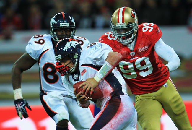 LONDON, ENGLAND - OCTOBER 31:  Manny Lawson #99 of San Francisco 49ers sacks Kyle Orton #8 of Denver Broncos during the NFL International Series match between Denver Broncos and San Francisco 49ers at Wembley Stadium on October 31, 2010 in London, England