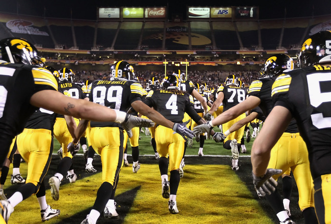 TEMPE, AZ - DECEMBER 28:  The Iowa Hawkeyes run out onto the field before the Insight Bowl against the Missouri Tigers at Sun Devil Stadium on December 28, 2010 in Tempe, Arizona.  The Hawkeyes defeated the Tigers 27-24.  (Photo by Christian Petersen/Gett