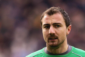 WIGAN, UNITED KINGDOM - FEBRUARY 11:  Jerzy Dudek of Liverpool in action during the Barclays Premiership match between Wigan Athletic and Liverpool at the JJB Stadium on February 11, 2006  in Wigan, England.  (Photo by Alex Livesey/Getty Images)