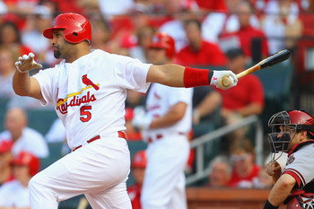 ST. LOUIS, MO - JULY 9: Albert Pujols #5 of the St. Louis Cardinals hits an RBI single against the Arizona Diamondbacks at Busch Stadium on July 9, 2011 in St. Louis, Missouri.  (Photo by Dilip Vishwanat/Getty Images)