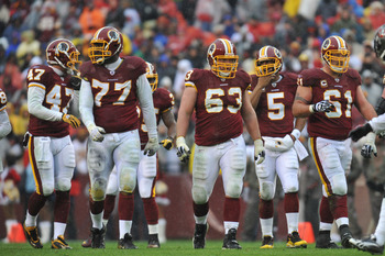 LANDOVER, MD - DECEMBER 12:  Casey Rabach #61 of the Washington Redskins walks up to the line of scrimmage with the offensive line during the game against the Tampa Bay Buccaneers  at FedExField on December 12, 2010 in Landover, Maryland. The Buccaneers d
