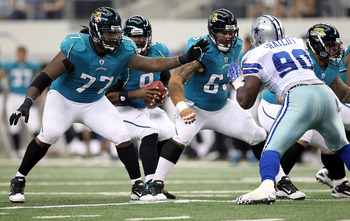 ARLINGTON, TX - OCTOBER 31:  (L-R) Offensive guard Uche Nwaneri #77 and center Brad Meester #63 of the Jacksonville Jaguars pass block against the Dallas Cowboys at Cowboys Stadium on October 31, 2010 in Arlington, Texas.  (Photo by Chris Chambers/Getty I