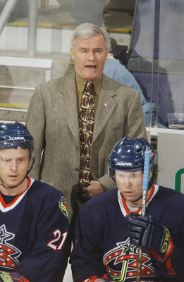 WASHINGTON - JANUARY 9:  Head coach Dave King of the Columbus Blue Jackets stands on the bench during the NHL game against the Washington Capitals on January 9, 2002 at MCI Center in Washington, D.C. The Capitals won 6-3.  (Photo by Mitchell Layton/Getty