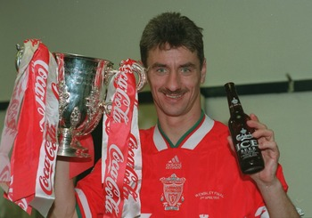 2 APR 1995: IAN RUSH OF LIVERPOOL HOLDS UP THE TROPHY AS HE CELEBRATES WITH A BOTTLE OF BEER AFTER BEATING BOLTON WANDERERS 2-1 TO WIN THE 1995 COCA COLA CUP FINAL AT WEMBLEY. PLEASE CREDIT: JUSTIN KEMP/ ALLSPORT