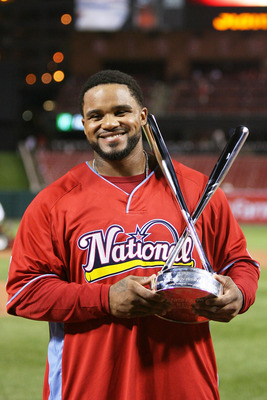 ST LOUIS, MO - JULY 13:  National League All-Star Prince Fielder of the Milwaukee Brewers celebrates with the trophy after winning the State Farm Home Run Derby at Busch Stadium on July 13, 2009 in St. Louis, Missouri.  (Photo by Elsa/Getty Images)
