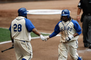 MILWAUKEE, WI - JULY 9:  Rickie Weeks #23 of the Milwaukee Brewers is congratulated b y Prince Fielder #28 after scoring a run against the Cincinnati Reds Miller Park on July 9, 2011 in Milwaukee, Wisconsin. (Photo by Scott Boehm/Getty Images)