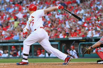 ST. LOUIS, MO - JULY 5: Matt Holliday #7 of the St. Louis Cardinals hits a three-run home run against the Cincinnati Reds at Busch Stadium on July 5, 2011 in St. Louis, Missouri.  (Photo by Dilip Vishwanat/Getty Images)