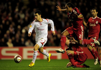 LIVERPOOL, ENGLAND - MARCH 18:  Eden Hazard of Lille breaks clear of the challenge of Glen Johnson of Liverpool during the UEFA Europa League Round of 16, second leg match at Anfield on March 18, 2010 in Liverpool, England.  (Photo by Shaun Botterill/Gett