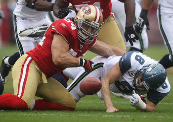 SAN FRANCISCO - DECEMBER 12:    Travis LaBoy #54 of the San Francisco 49ers sacks Matt Hasselbeck #8 of the Seattle Seahawks during an NFL game at Candlestick Park on December 12, 2010 in San Francisco, California.  (Photo by Jed Jacobsohn/Getty Images)