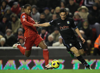 LIVERPOOL, ENGLAND - DECEMBER 06:   Stewart Downing of Aston Villa  is challenged by Glen Johnson of Liverpool during the Barclays Premier League match between Liverpool and Aston Villa at Anfield on December 6, 2010 in Liverpool, England. (Photo by Mark