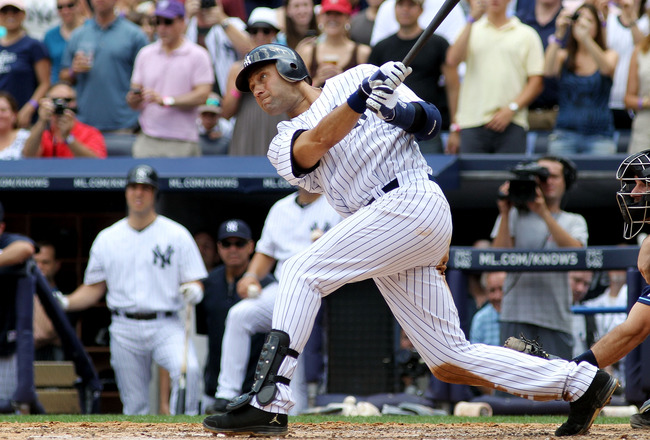 NEW YORK, NY - JULY 09:  Derek Jeter #2 of the New York Yankees hits a solo home run in the third inning for career hit 3000 while playing against the Tampa Bay Rays at Yankee Stadium on July 9, 2011 in the Bronx borough of New York City.  (Photo by Micha