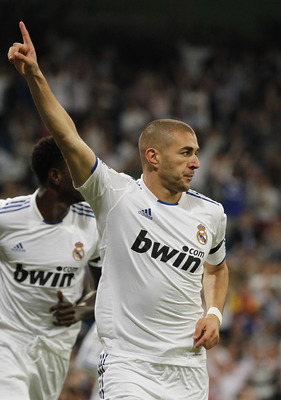MADRID, SPAIN - MAY 10:  Karim Benzema of Real Madrid celebrates after scoring his side third goal during the La Liga match between Real Madrid and Getafe at Estadio Santiago Bernabeu on May 10, 2011 in Madrid, Spain.  (Photo by Angel Martinez/Getty Image