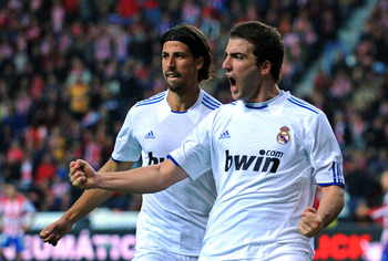 GIJON, SPAIN - NOVEMBER 14:  Gonzalo Higuain (R) of Real Madrid celebrates beside team mate Sami Khedira after scoring Real's first goal during the La Liga match between Sporting Gijon and Real Madrid at El Molinon Stadium on November 14, 2010 in Gijon, S