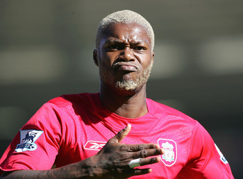 BIRMINGHAM, ENGLAND - SEPTEMBER 24: Djibril Cisse of Liverpool celebrates scoring during the Barclays Premiership match between Birmingham City and Liverpool at St Andrews Stadium on September 24, 2005 in Birmingham, England.  (Photo by Phil Cole/Getty Im
