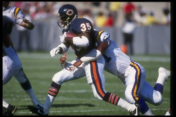 Running back Neal Anderson of the Chicago Bears moves the ball during a game against the Minnesota Vikings at Soldier Field in Chicago, Illinois. The Bears won the game, 10-6.