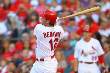 ST. LOUIS, MO - JULY 8: Lance Berkman #12 of the St. Louis Cardinals hits a solo home run against the Arizona Diamondbacks at Busch Stadium on July 8, 2011 in St. Louis, Missouri.  (Photo by Dilip Vishwanat/Getty Images)