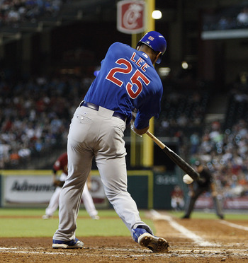 HOUSTON - JUNE 06:  Derrek Lee #25 of the Chicago Cubs hits a line drive to center field in the eighth inning against the Houston Astros at Minute Maid Park on June 6, 2010 in Houston, Texas.  (Photo by Bob Levey/Getty Images)
