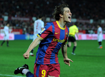 SEVILLE, SPAIN - MARCH 13:  Bojan Krkic of Barcelona celebrates scoring his sides opening goal during the la Liga match between Sevilla and Barcelona at Estadio Ramon Sanchez Pizjuan on March 13, 2011 in Seville, Spain.  (Photo by Jasper Juinen/Getty Imag