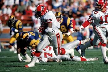 ANAHEIM, CA - DECEMBER 13:  Running back Gerald Riggs #42 of the Atlanta Falcons rushes for yards during a game against the Los Angeles Rams at Anaheim Stadium on December 13, 1987 in Anaheim, California.  The Rams won 33-0.  (Photo by George Rose/Getty I