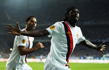 POZNAN, POLAND - NOVEMBER 04:  Emmanuel Adebayor of Manchester City celebrates scoring during the UEFA Europa League Group A match between KKS Lech Poznan and Manchester City at the Bulgarska Street Stadium on November 4, 2010 in Poznan, Poland.  (Photo b