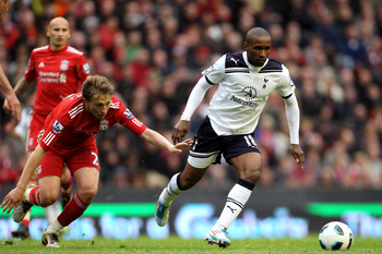 LIVERPOOL, ENGLAND - MAY 15:  Jermain Defoe of Spurs goes past Lucas of Liverpool during the Barclays Premier League match between Liverpool and Tottenham Hotspur at Anfield on May 15, 2011 in Liverpool, England.  (Photo by Michael Steele/Getty Images)