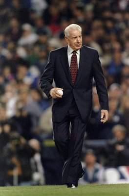 20 Oct 1996:  Baseball great Joe Dimaggio walks out to the pitchers mound to throw out the first pitch of the 1996 World Series Game One between the Atlanta Braves and the New York Yankees at Yankee Stadium in the Bronx, New York. The Braves defeated the