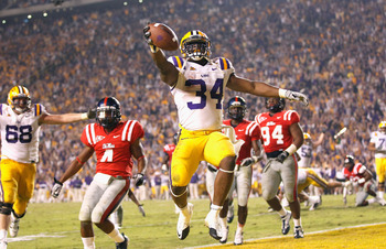 BATON ROUGE, LA - NOVEMBER 20:  Stevan Ridley #34 of the Louisiana State University Tigers scores the go-ahead toucdown in the final minutes of the fourth quarter against the Ole Miss Rebels at Tiger Stadium on November 20, 2010 in Baton Rouge, Louisiana.