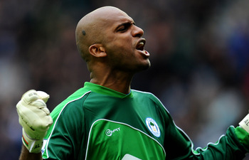 WIGAN, ENGLAND - MAY 15:  Ali Al Habsi of Wigan Athletic celebrates his team's second goal during the Barclays Premier League match between Wigan Athletic and West Ham United at the DW Stadium on May 15, 2011 in Wigan, England.  (Photo by Clive Mason/Gett