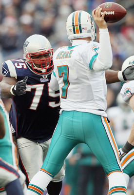 FOXBORO, MA - JANUARY 02:  Vince Wilfork #75 of the New England Patriots pressures Chad Henne #7 of the Miami Dolphins on January 2, 2011 at Gillette Stadium in Foxboro, Massachusetts.  (Photo by Elsa/Getty Images)
