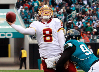 JACKSONVILLE, FL - DECEMBER 26:  Quarterback Rex Grossman #8 of the Washington Redskins is pressured by Jeremy Mincey #94 of the Jacksonville Jaguars during the game at EverBank Field on December 26, 2010 in Jacksonville, Florida.  (Photo by Sam Greenwood
