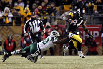 PITTSBURGH, PA - JANUARY 23:  Rashard Mendenhall #34 of the Pittsburgh Steelers runs down field against Brodney Pool #22 of the New York Jets during the 2011 AFC Championship game at Heinz Field on January 23, 2011 in Pittsburgh, Pennsylvania.  (Photo by